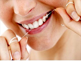 how to clean plaque between teeth